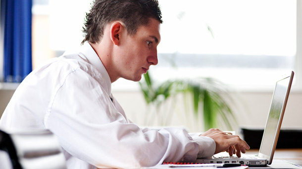 man studying at laptop